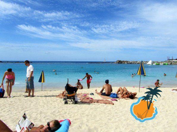 Sunbathing On Amadores Beach Beach