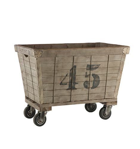 9b2a7933c05f Inspired by industrial style laundry carts, this piece is made of ...