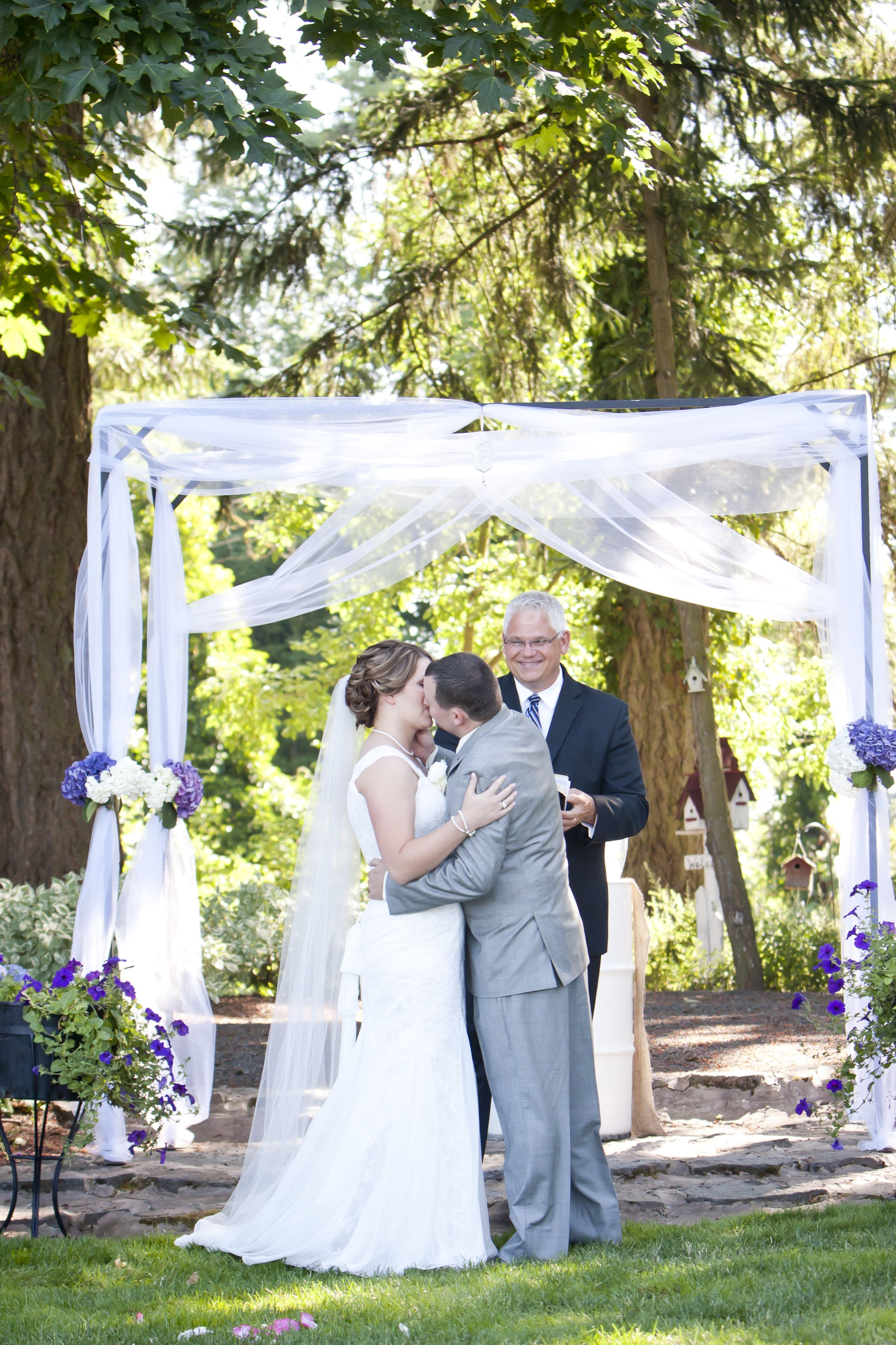 The Kiss Kaylee Rad Photography Outdoor Wedding Tulle Alter Purple And