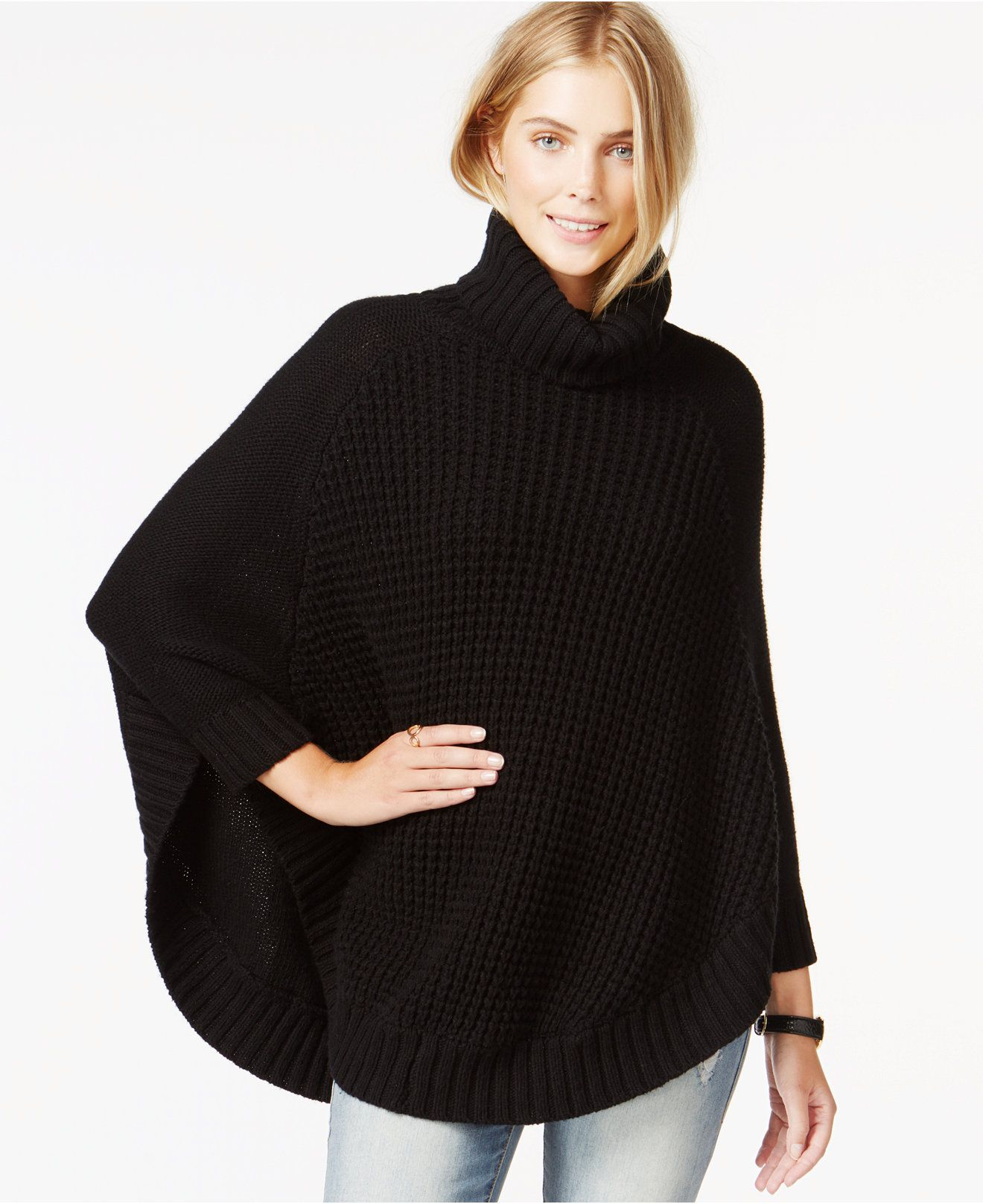 Celebrate sweater season in draped style. Texture meets dark tones to bring you this stand-out seasonal must-have. Pair this poncho with your favorite skinnies and heels for an ultra-chic look.