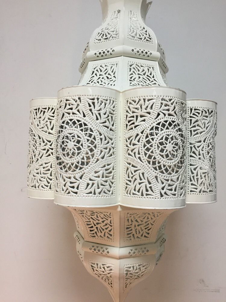 Moroccan Carved Metal Pendant Lantern in White  WE HAVE THIS MAGNIFICENT PENDANT LANTERN  HANDMADE IN MOROCCO  FEATURES A WHITE HAND PAINTED ENAMEL FINISH  PLEASE SEE THE IMAGES AS PART OF THE DESCRIPTION ITEM IS IN NEW CONDITION UL - WIRE READ...