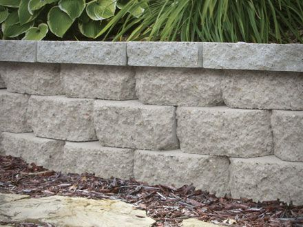 Installing A Retaining Wall At Menards Backyard Landscaping Backyard Fences Brick Garden