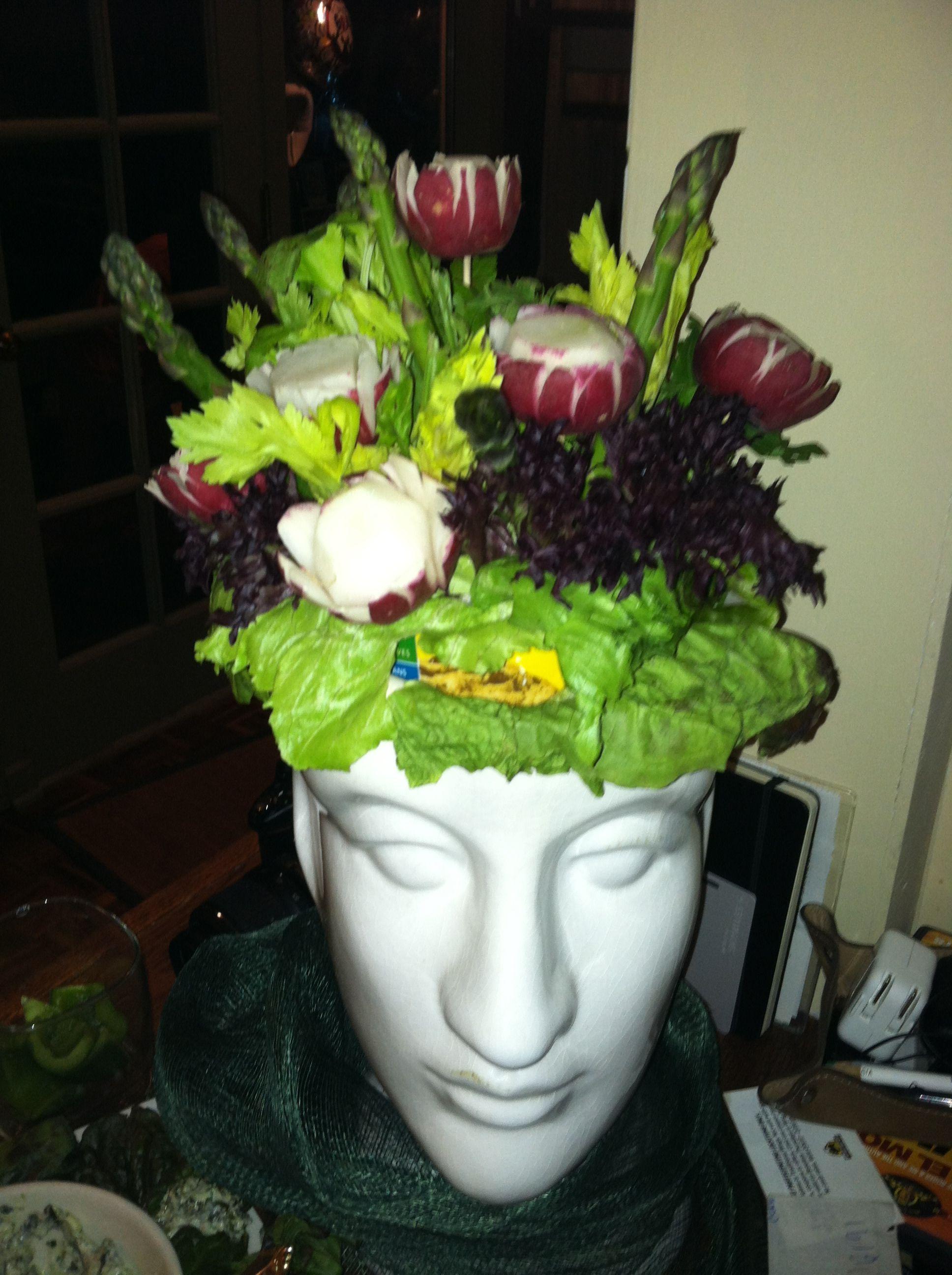 Use a flower pot to make an edible veggie arrangement