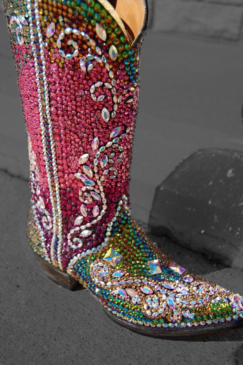 WHAM! BAM! GLITZ AND GLAM! BY JACQI BLING STYLE- Calling all boot vixens, it's time to step up your Glitz Game! Venture into the Va Va Voom territory with these ready-to-bling boots. Certified over-the-top they throw sparkle like nothing else around. Flaunting an insane amount of crystals in pink, purple, teal, gold and AB, they surpass all the rules of glam!