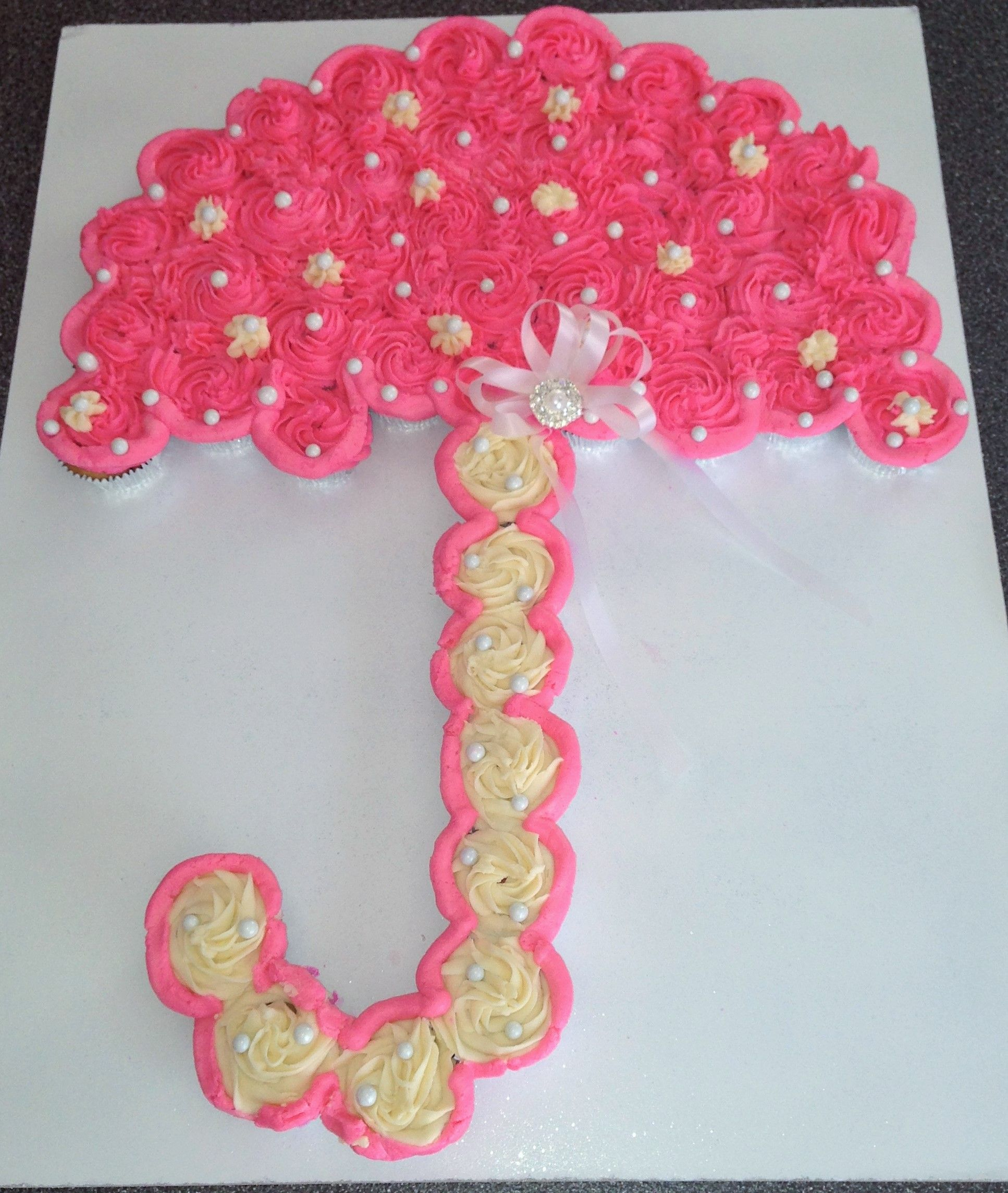 Baby Girl shower with pull apart umbrella shaped cupcakes Cakes