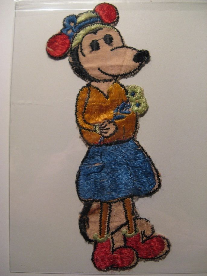 Old fabrics emblem side of Minnie Mouse...comes from the 30s...