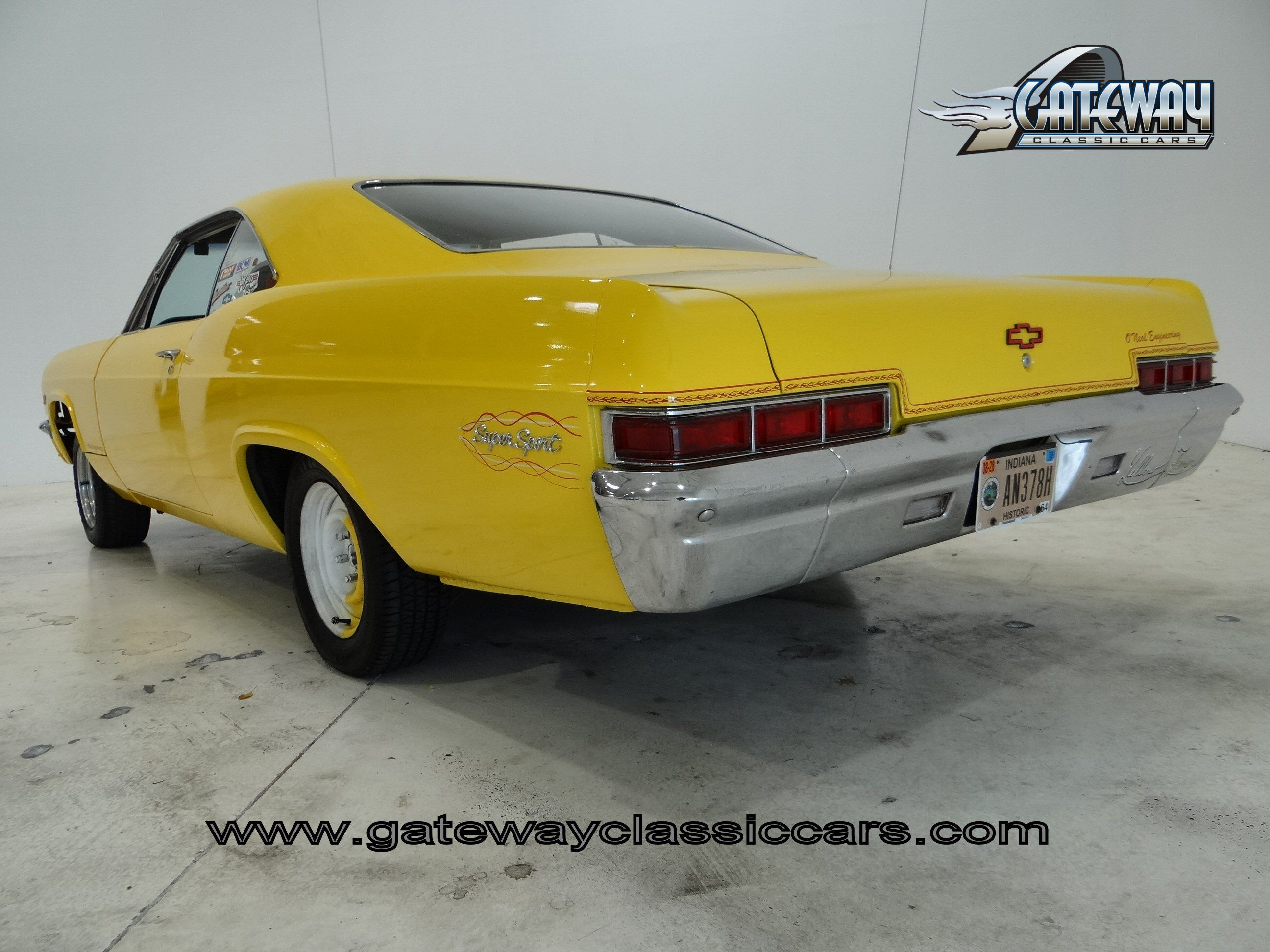 For sale in our chicago illinois showroom is a yellow 1966 chevrolet impala super sport clone 350 cid turbo 350 auto