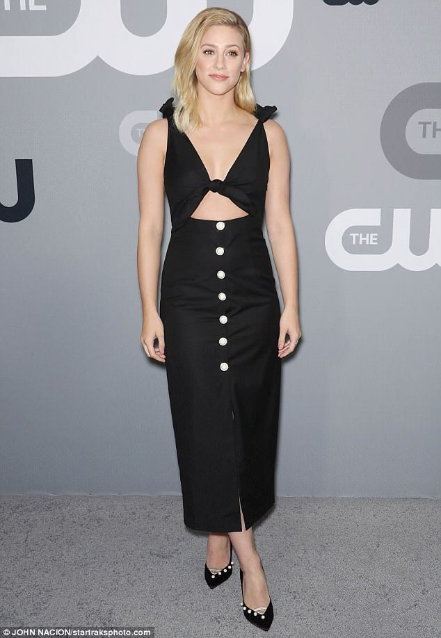 Lili Reinhart smolders in chic black dress with sexy midriff cut-out