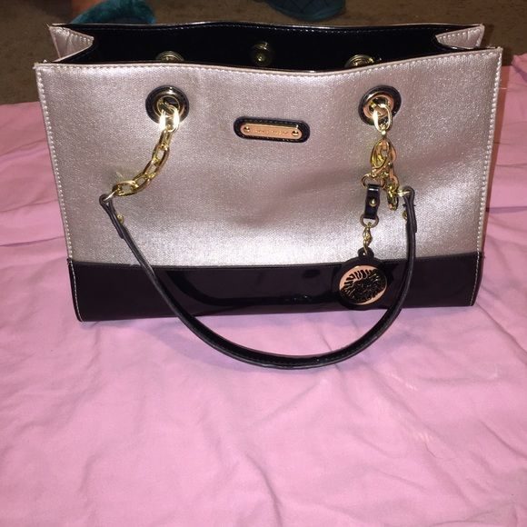 Anne Klein tote Gently used. Shiny goldish champagne color with black pvc authentic. Very spacious. Anne Klein Bags Totes