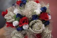 I have made the flowers and decorations for several weddings and receptions through the years.  The only difference from my flowers and a florist - is that I have to work in silk flowers. triunitycreations@charter.net