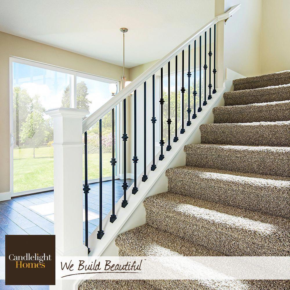 Step up your style with an elegant staircase! #CandlelightHomes #utahhomes #utahbuilder #webuildbeautiful #homedecor #interiordesign #staircase #home #utah #banisterremodel