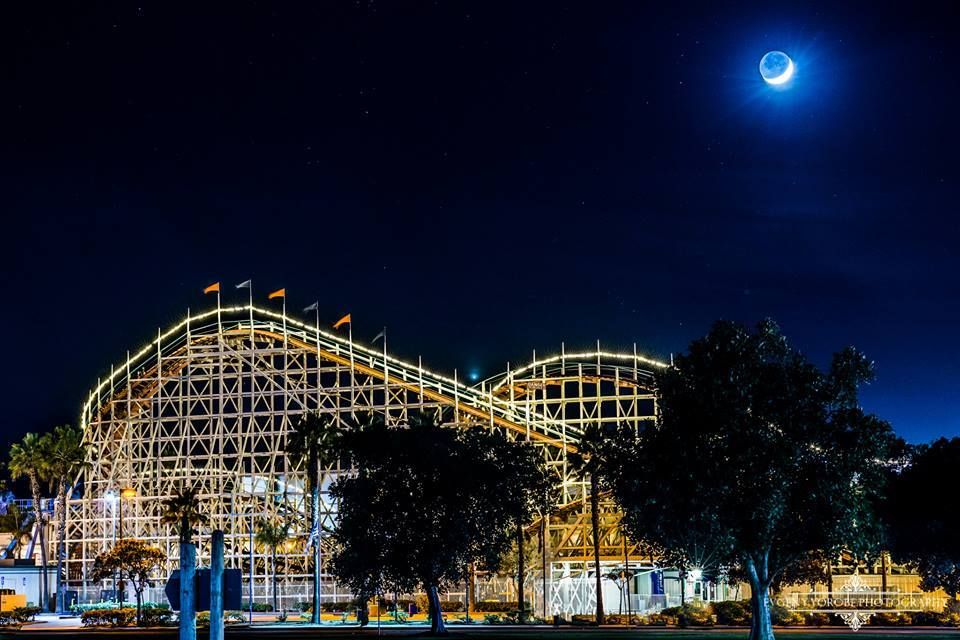 Venus and the Waxing Crescent Moon setting over the Belmont Park Giant Dipper Roller Coaster in Mission Beach. Venus can be seen directly in between the two roller coaster dips. Photo by Evgeny Yorobe Photography.