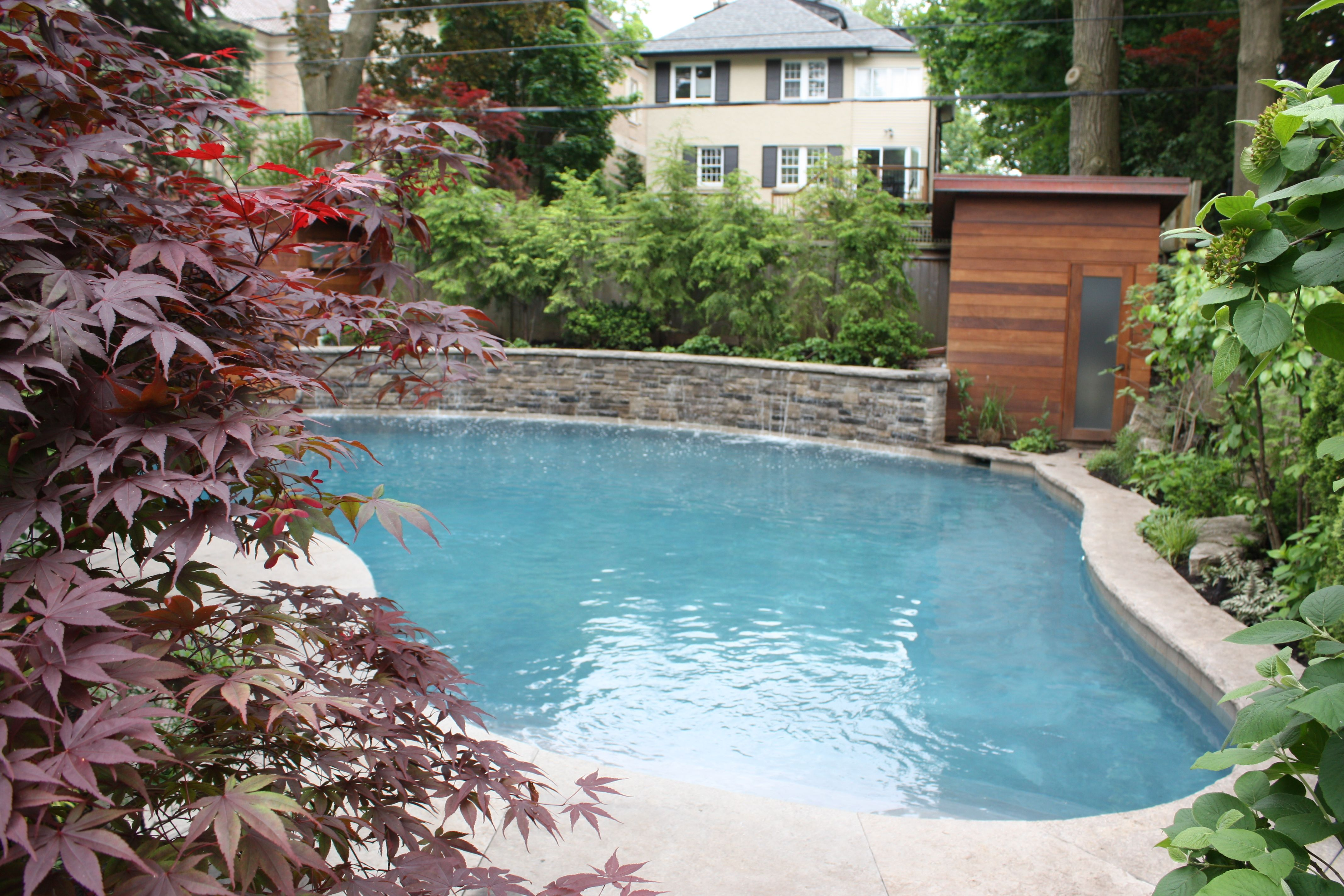Pretty backyard pool area with waterfall