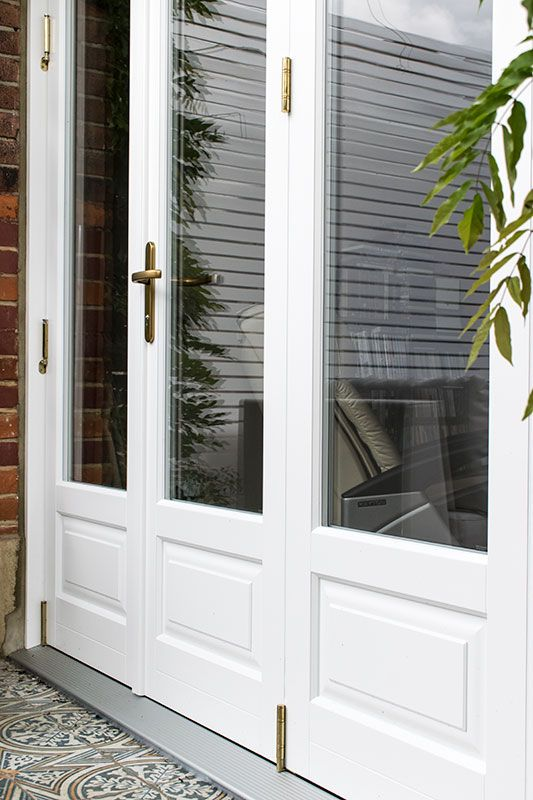 Timber bifold doors with stained glass windows in Finchley North London & Timber bifold doors with stained glass windows in Finchley North ...