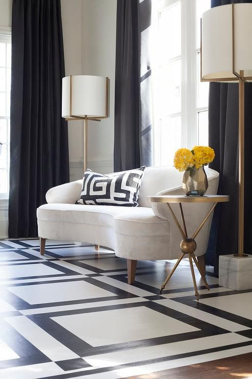 Clad In Black And White Geometric Floor Tiles This