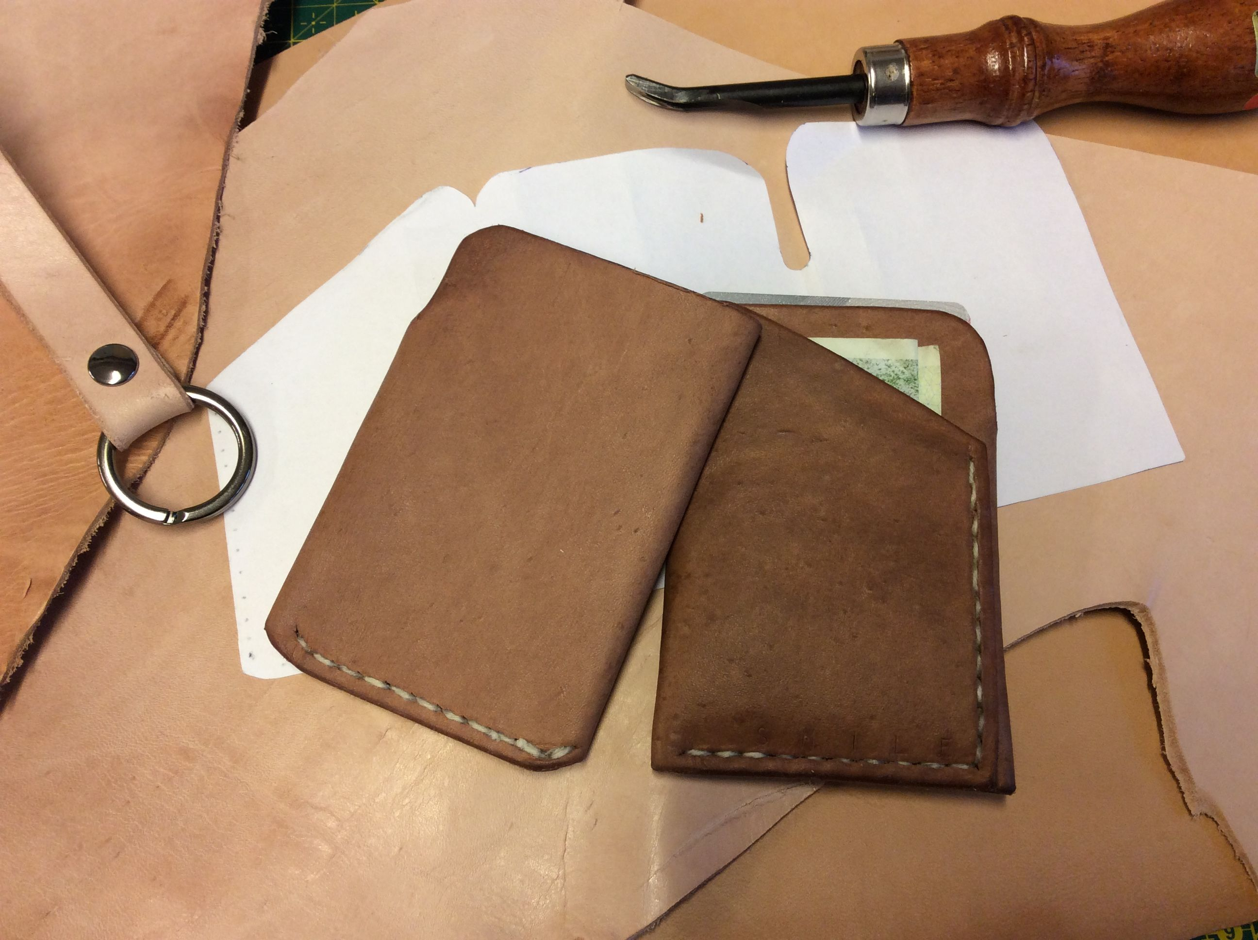 Handmade cardholder. Veg. oiled leather. Notice how the vertical stiches doesn't go all the way through.