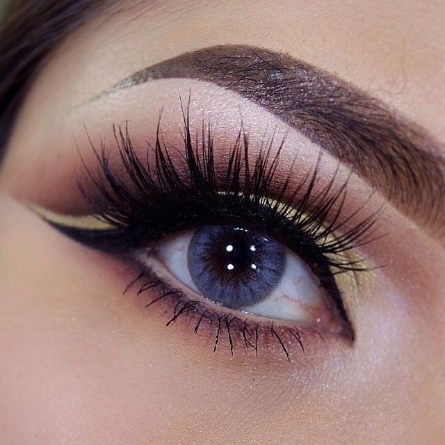 makeup with false lashes, great eyebrows, liner..