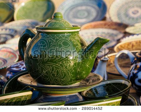 Green ceramic teapot in Bukhara, Uzbekistan - stock photo