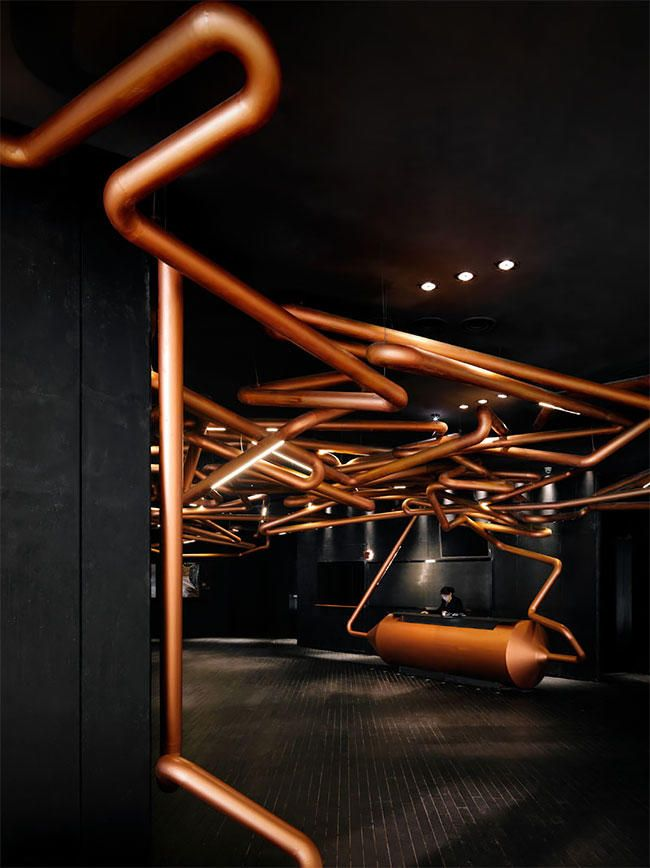 Futuristic Copper Pipes Brilliantly Run Through This Cinema Cinema Design Interior Design Awards German Design