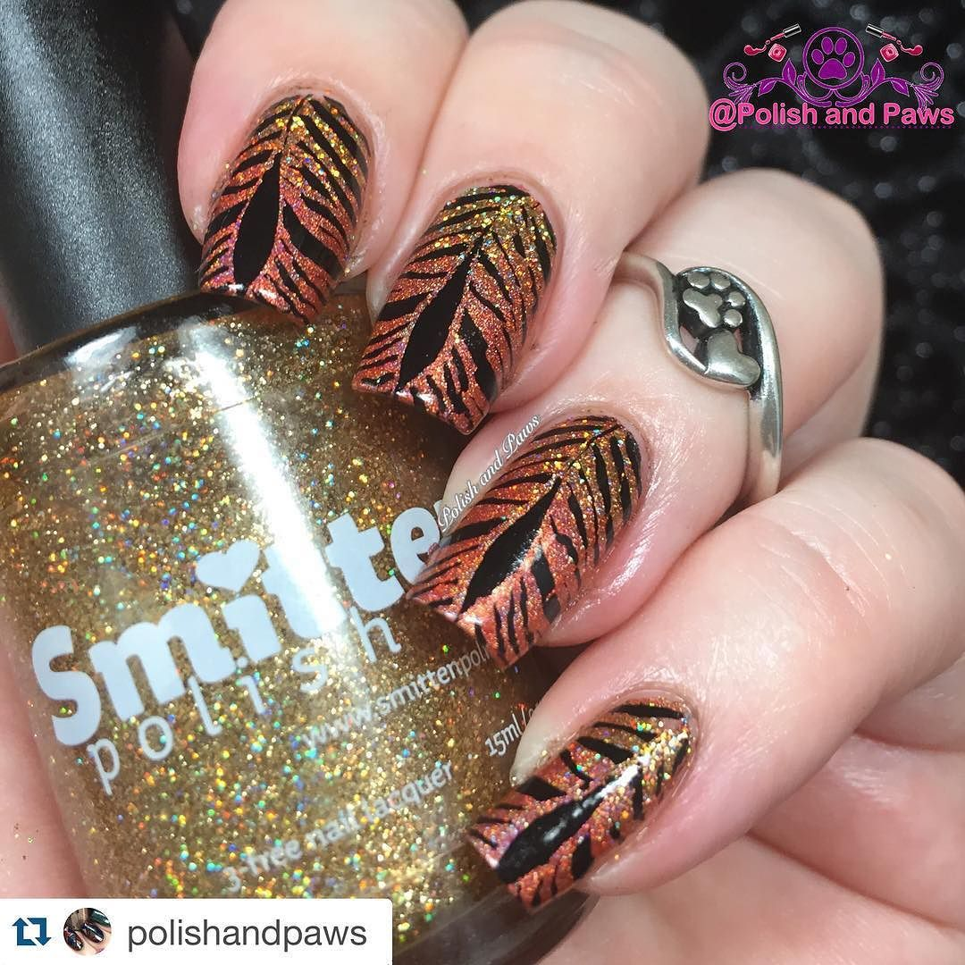 #Repost @polishandpaws with @repostapp.  For day 17 of #clairestelle8jan (yup Im early again!) The prompt is 'Forest Creatures' For this mani I started with a gradient of @smittenpolish Cecil the Lion and Bengal Tiger (from @hellaholocustoms )  then stamped tiger stripes from BM-613 plate with MdU black.  And of course I used the jelly C Thru stamper from @cosette.nail.shop for precise placement!  I love this mani.. and I hope you all do too!  #nailpolish #nails #nailswatches #polishaddict…