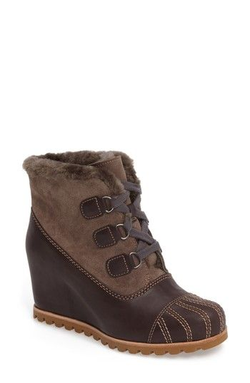 8775f5d6d57 Free shipping and returns on UGG® Alasdair Waterproof Wedge Bootie (Women)  at Nordstrom.com. A seam-sealed bootie lifted by a covered wedge is warmed  by ...