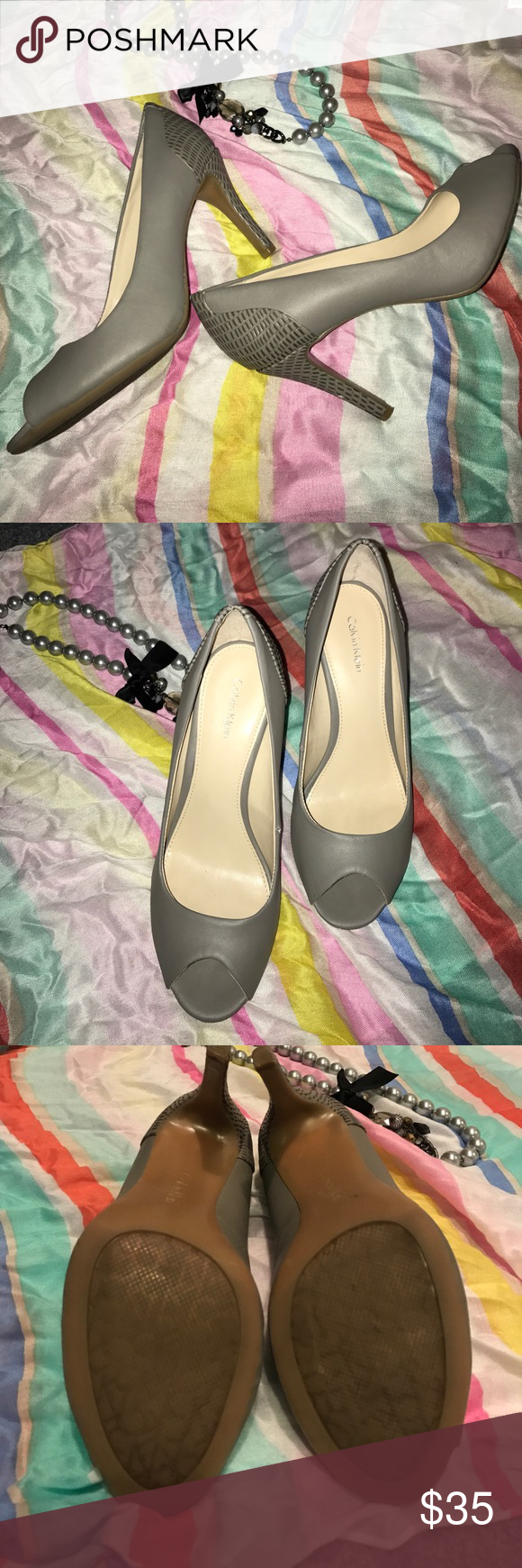 """Calvin Klein grey peep toe Calvin Klein grey peep toe 3 1/2"""" heel. Worn once. Has comfy rubber sole and soft leather. Great for standing on your feet all day. As with ALL of my listings, if you place in bundle (other items not required) I Will offer you a private sale!  🌿 Calvin Klein Collection Shoes Heels"""