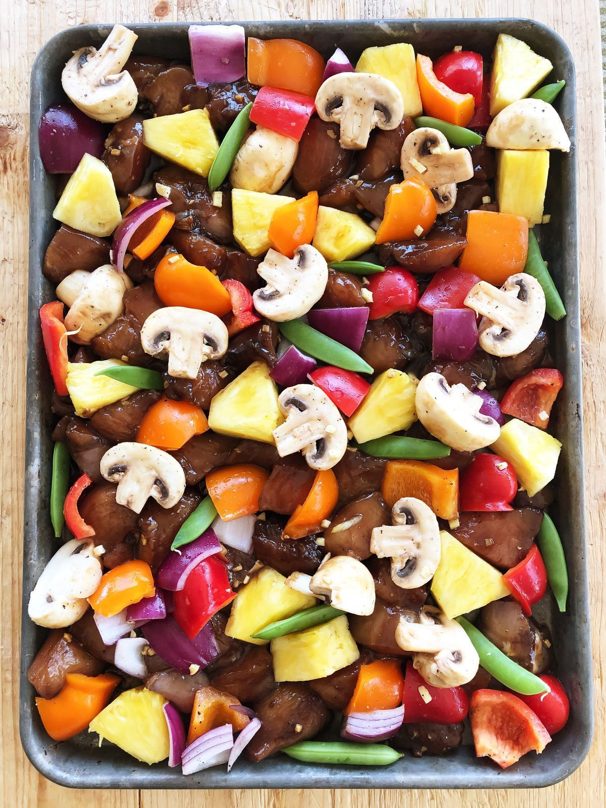 This Hawaiian Chicken Sheet Pan Supper is made with chunks of flavourful marinated chicken, roasted vegetables and roasted pineapple. A simple and quick dinner that everyone will love! #sheetpansuppers This Hawaiian Chicken Sheet Pan Supper is made with chunks of flavourful marinated chicken, roasted vegetables and roasted pineapple. A simple and quick dinner that everyone will love! #sheetpansuppers This Hawaiian Chicken Sheet Pan Supper is made with chunks of flavourful marinated chicken, #sheetpansuppers