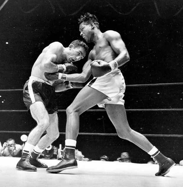 Yankee Stadium, New York City, Sept. 23, 1957. Basilio wins the Middle Weight title by beating Sugar Ray Robinson with a 15-round decision. http://media.syracuse.com/post-standard/photo/2012/11/11834053-mmmain.jpg