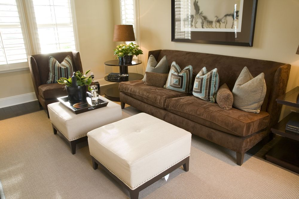 Compact Living Room With Dark Mocha Chair And Armless Sofa, Contrasting  With White Single