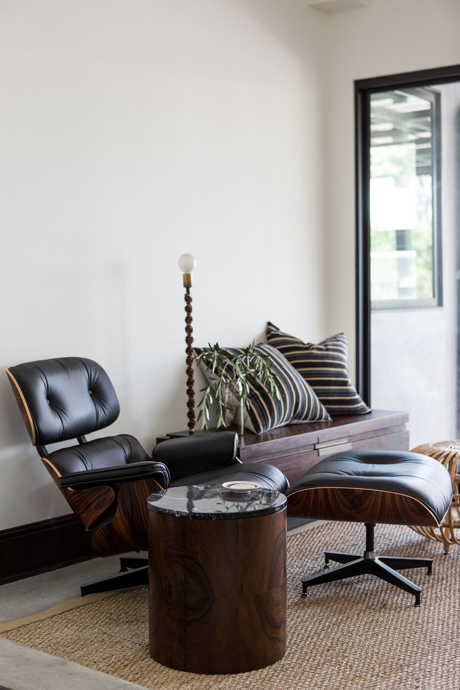 Featuring a classic eames chair from design within reach a