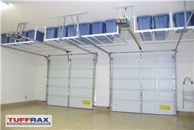 Another Example Of Hanging Storage Over The Garage Doors Garage Overhead Storage Solutions Google Search Garage Organization Garage Decor Garage Storage