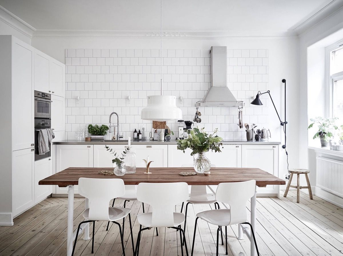 Eclectic And Oh So Stylish The Scandinavian Theme Stretches To Most Living Dining And Bed Scandinavian Kitchen Design Trendy Dining Room White Modern Kitchen