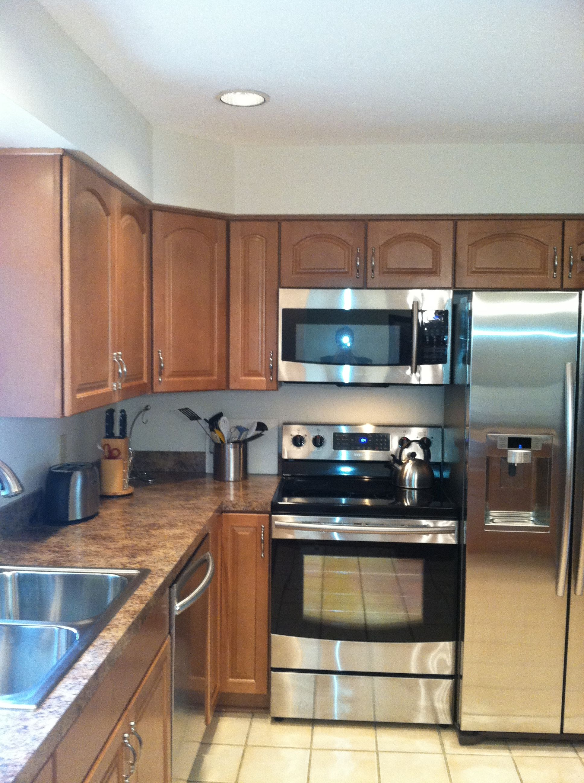 Stainless Steel And Black Appliances With WayPoint Maple 451S Spice  Cabinets And Formica Butterum Granite High Definition Countertops.