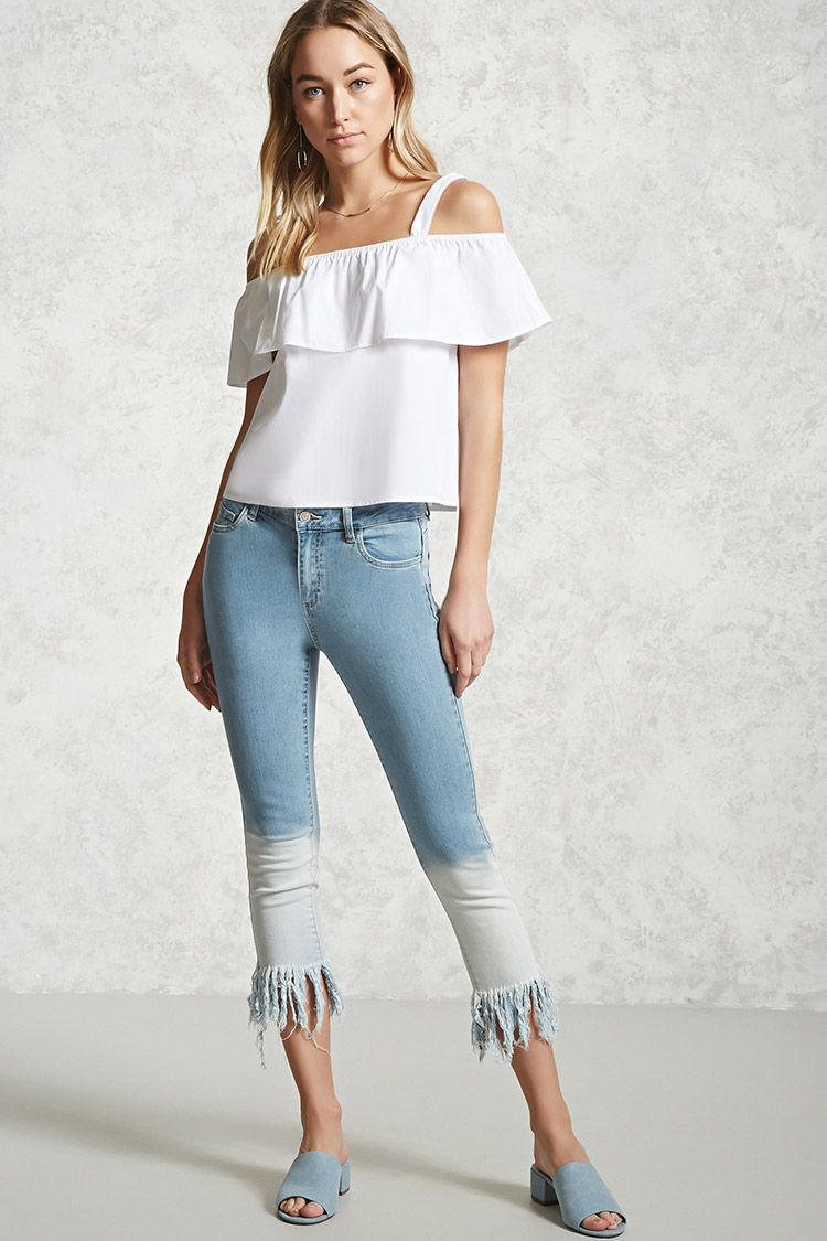 A pair of jeans featuring an ombre wash, a five-pocket construction, mid