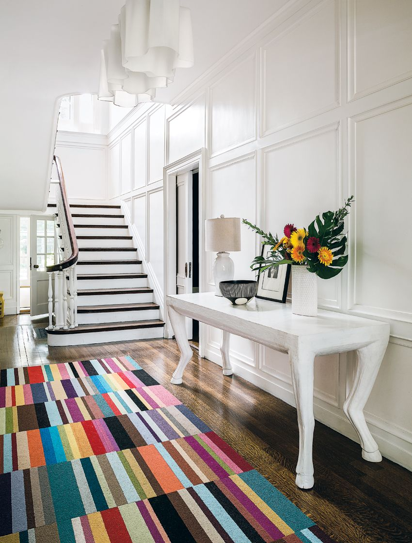 Brookline home renovation history 2 kate patterson design airy classic staircase patterned colorful carpet on wooden floor cool side table with animal legs dailygadgetfo Images