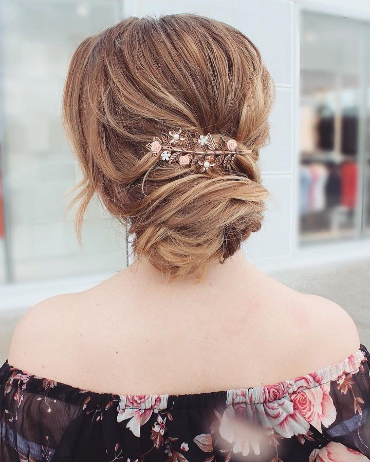 Wedding updo hairstyle with hair accessories #updohairstyle #weddinghair #messyupdo