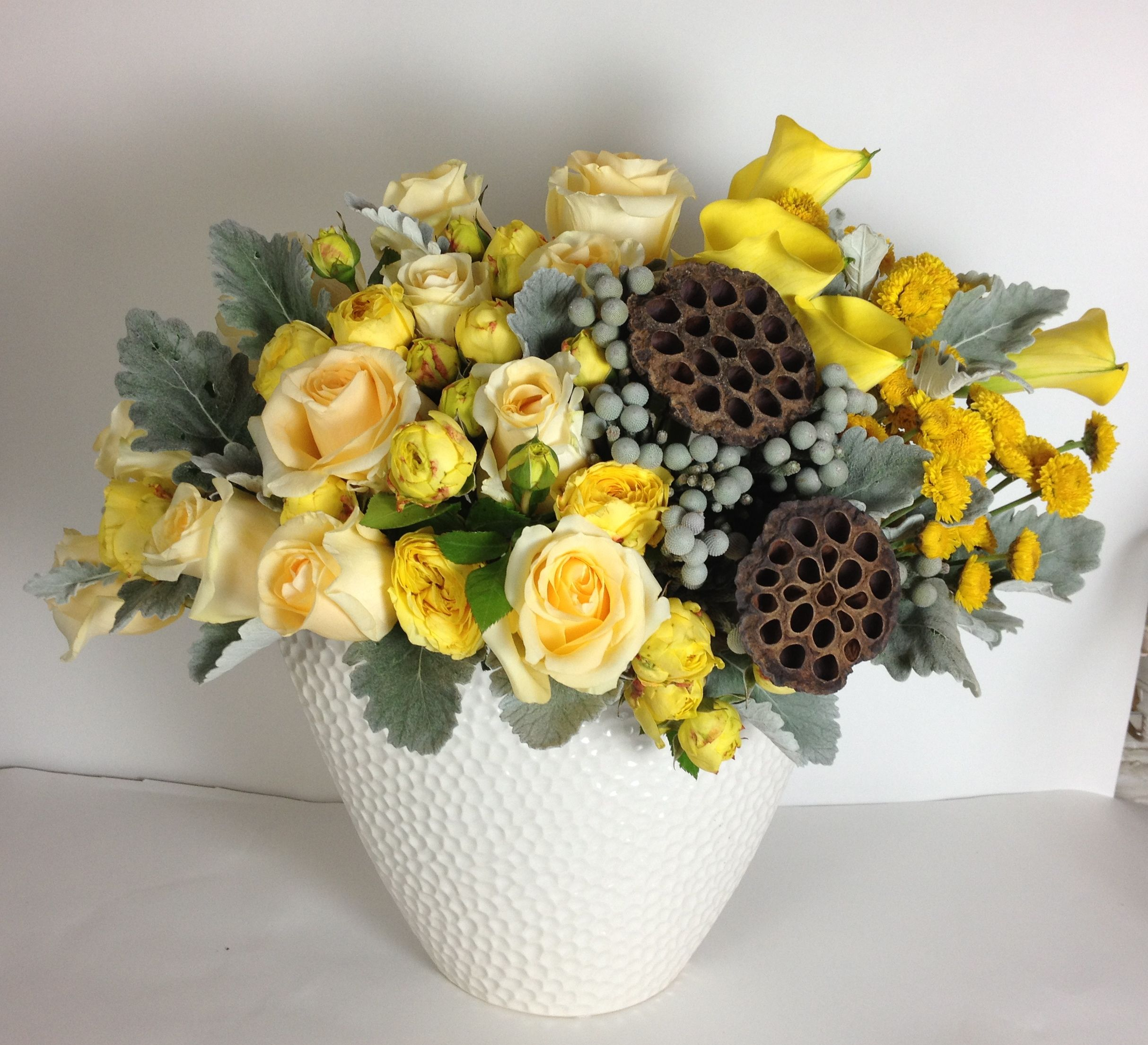 Yellow arrangement with lotus pods Same day flower