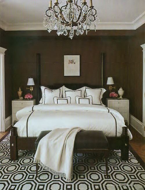 bedding + chocolate walls + chandelier