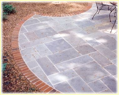 A Stone Patio With Brick Border Extending From The House To The Existing  Patio Is An Alternative To A Deck.
