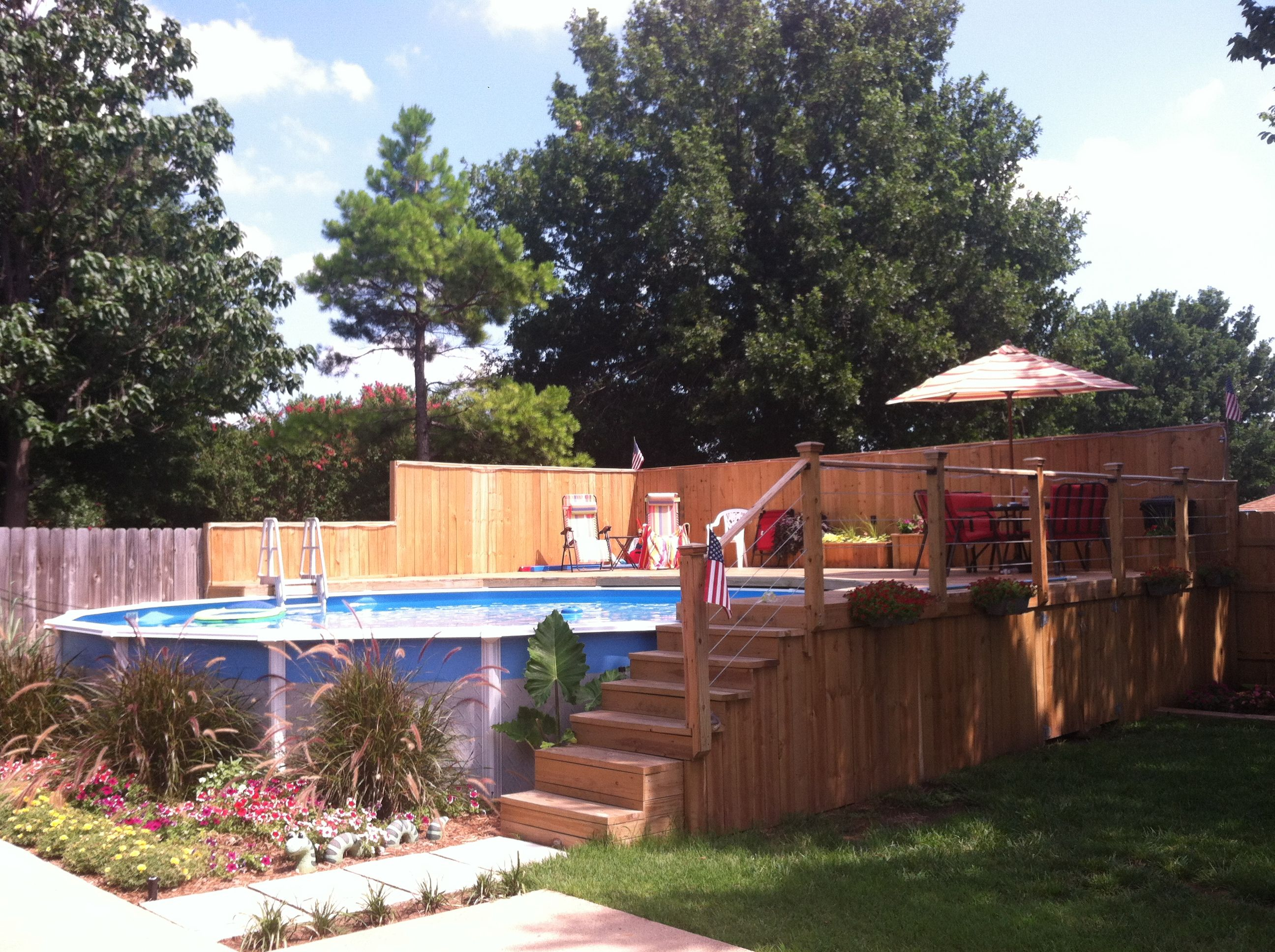 Garden Ideas Around Swimming Pools above ground pool, but build a deck around it and it looks