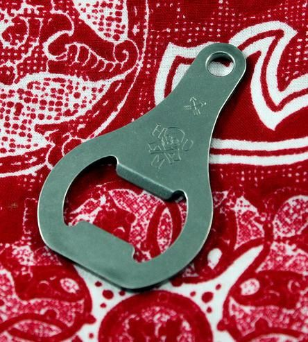 This vintage-inspired bottle opener clips onto a keyring or lanyard, to keep handy whenever you might need it. It's crafted in heavy-duty stainless steel, and the tabs have been sanded and filed to a satiny smooth finish. To pop a top, angle the opener around the bottle cap, stick your thumb on the logo and lift your way to a fresh cold one.
