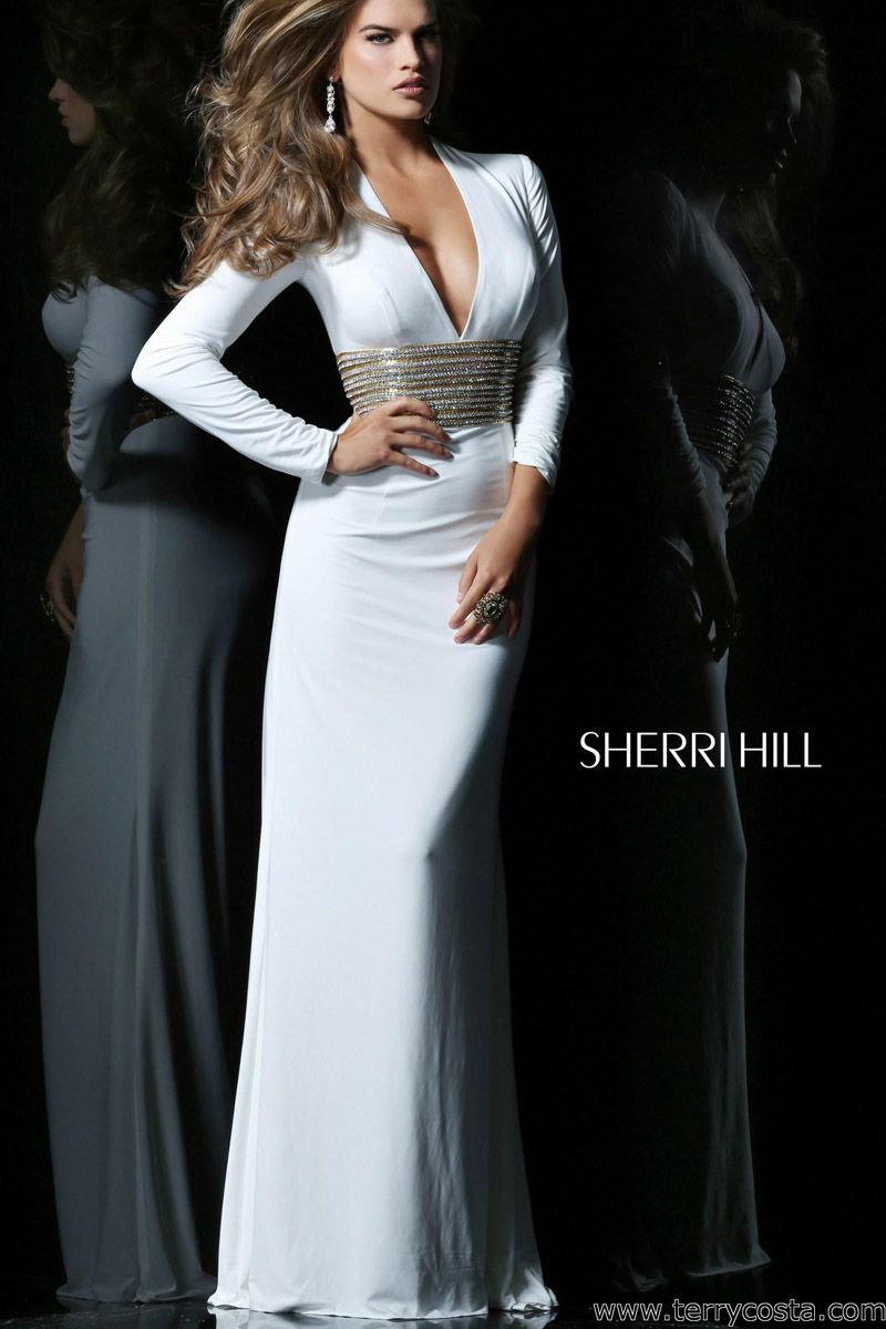 e43bcfe7101b Sherri Hill 1580 on @Terry Costa - This sexy gown by Sherri Hill is perfect  for a prom or pageant dress features a deep v-shaped neckline and long  sleeves.