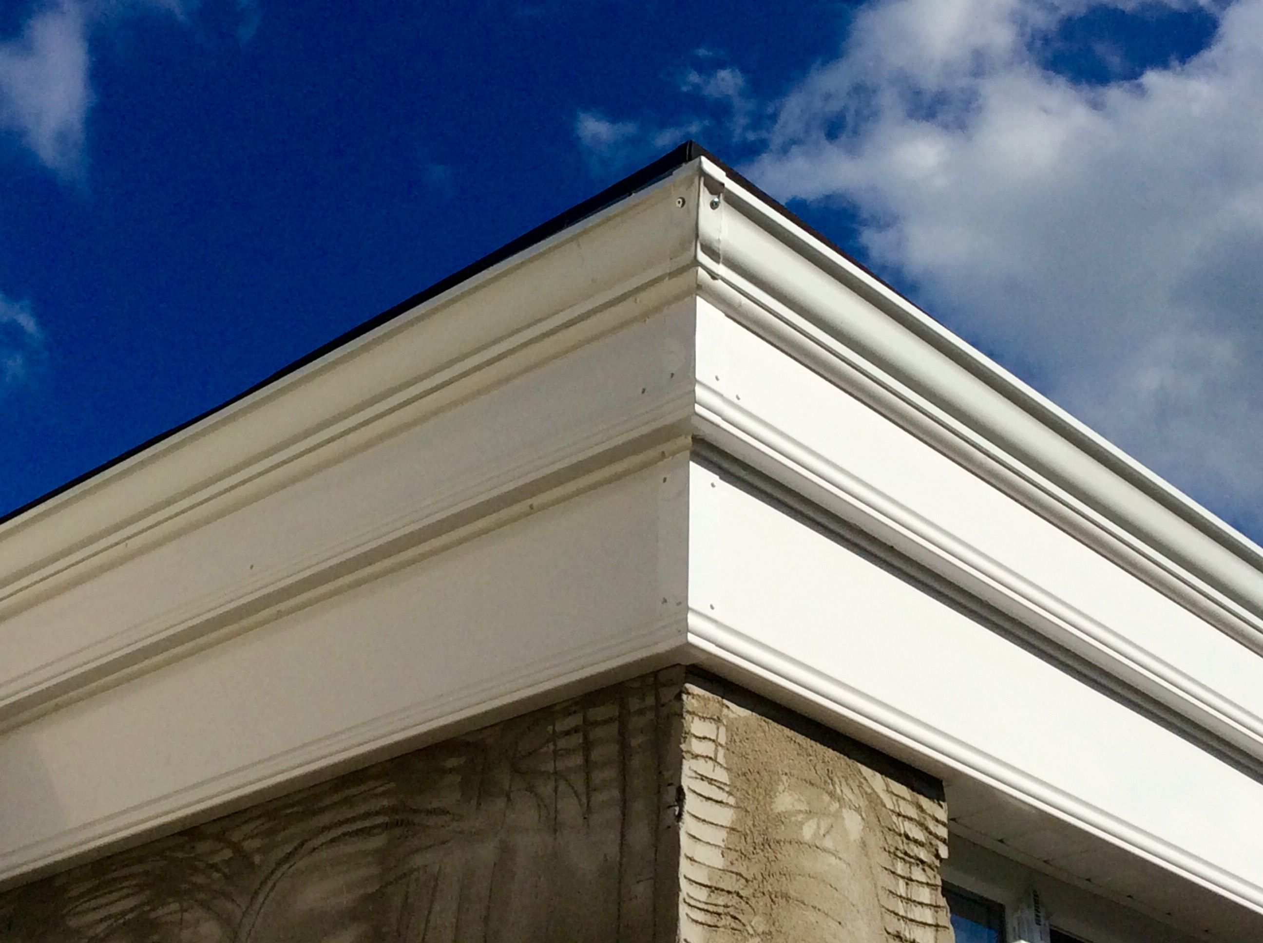 seamless gutters with PVC fascia boards on a orangery style