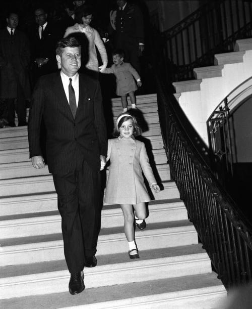 The President and Caroline followed by Jackie and John Jr, November 1963