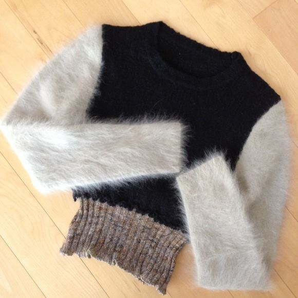 """NWT One-of-a-kind angora/wool blend designer top NWT from a hip little boutique in San Francisco's North Beach neighborhood. The owner/designer makes way cool items by ripping apart different pieces of clothing & recombining them her way! So: the body of the sweater is a black wool, with a melange of beiges in the ribbed bottom; & sleeves are fluffy soft taupe Angora. 18"""" long from shoulder to bottom of ribbed knit, sleeves 23"""" from top of shoulder. Truly one-of-a-kind, you will never find…"""