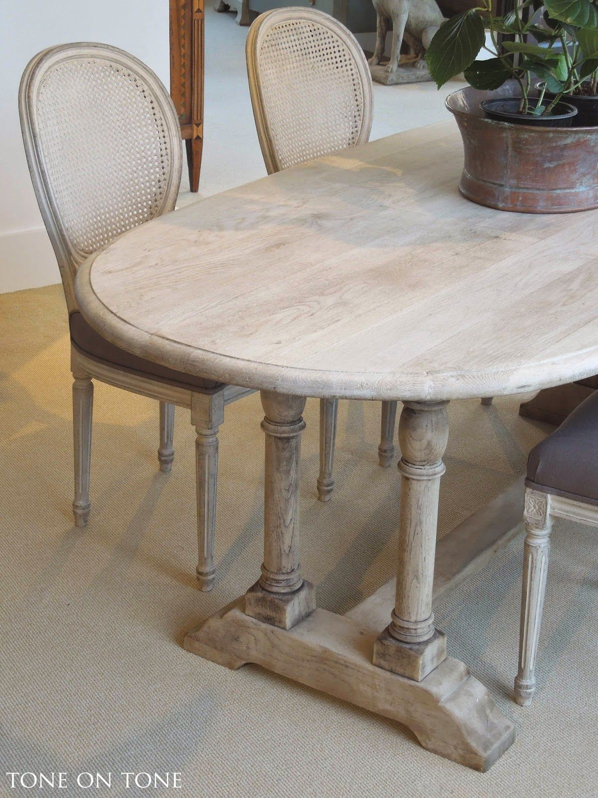 Here is a 19th century belgian bleached oak dining kitchen table with oval top and trestle base