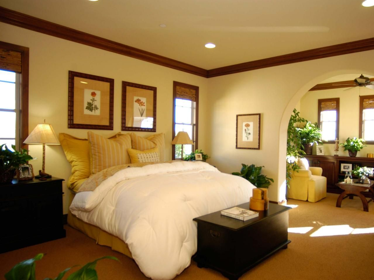 This cozy, contemporary bedroom features a spacious sitting area ...