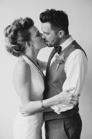 Sweetgrass Social Weddings. Styled Shoot: A Giving Back Wedding. Silver and Gold details. Bride and Groom kiss.