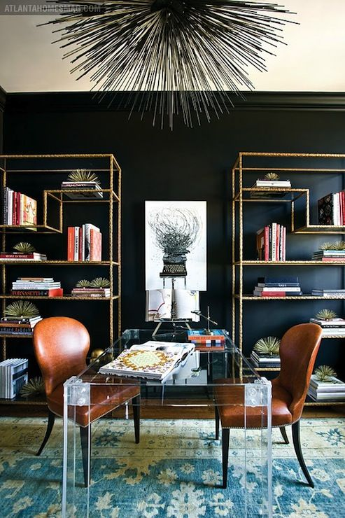 This KILLS ME. Lucite desk, leather chairs...rug...black wall, brass bookshelves