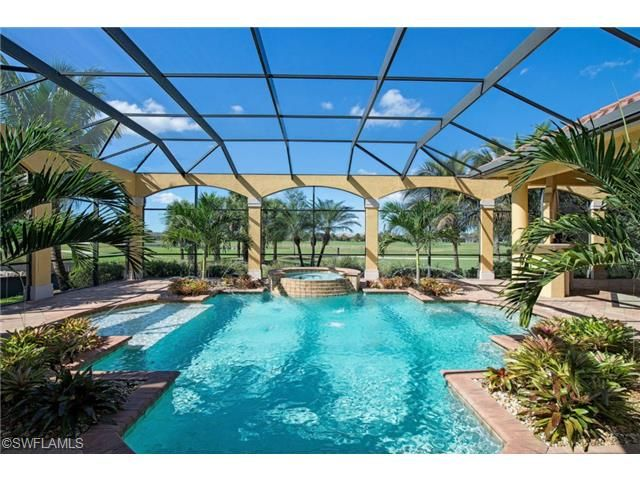 Very large pool and spa with screened lanai in twin eagles for Florida lanai designs